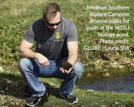 Missouri Southern student Cameron Priester looks for snails